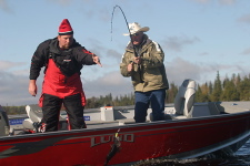 Bobby Crow helps Hoyt Corkins reel in another